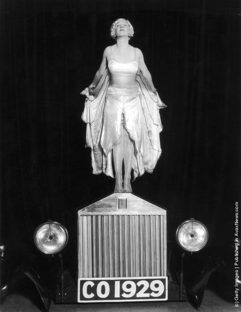1929: Entertainer Elsa McFarlane stands on the bonnet of a Rolls Royce car, mimicking the Silver Lady figurine, in a production of 'The Co-Optimists', at the Vaudeville Theatre in London