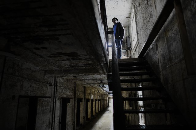 Former inmate at Eastern State Penitentiary, William Harrison, 75, served 3 separate terms (1959, 1962, 1970) for larceny, forgery, and assault, and revisits his prison cell on the second level of block 14 in Philadelphia, Pennsylvania April 30, 2014. (Photo by Mark Makela/Reuters)