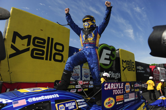 In this photo provided by the NHRA, Ron Capps, the current Funny Car world champion, celebrates after he ran a 3.933 at 322.65 in his Dodge Charger for his first NHRA Four-Wide Nationals win of his career, at zMax Dragway, Concord, N.C., Sunday, April 30, 2017. (Photo by Teresea Long/NHRA via AP Photo)