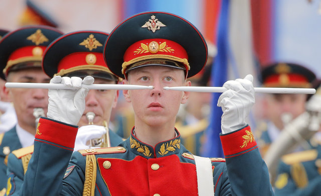 A Russian military band performs at Red Square during the Victory Day military parade in Moscow on May 9, 2017. Russia marks the 72nd anniversary of the Soviet Union's victory over Nazi Germany in World War Two. (Photo by Yuri Kochetkov/AFP Photo)