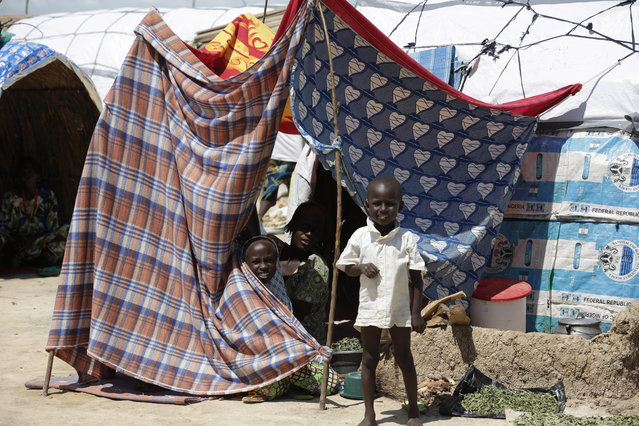 In this Sunday, August 28, 2016 file photo, a child plays in a makeshift tent camp for people displaced by Islamist Extremist in Maiduguri, Nigeria. (Photo by Sunday Alamba/AP Photo)