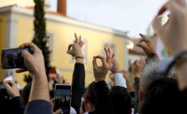 Demonstrators gesture during a police officers' protest to demand better working conditions in Lisbon, Portugal on November 21, 2019. (Photo by Rafael Marchante/Reuters)