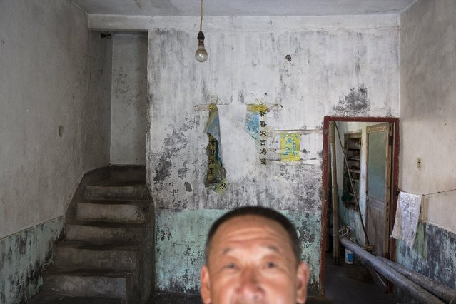Sun Ayue, one of a few remaining residents, stands in his home in the abandoned fishing village of Houtouwan on the island of Shengshan July 26, 2015. (Photo by Damir Sagolj/Reuters)