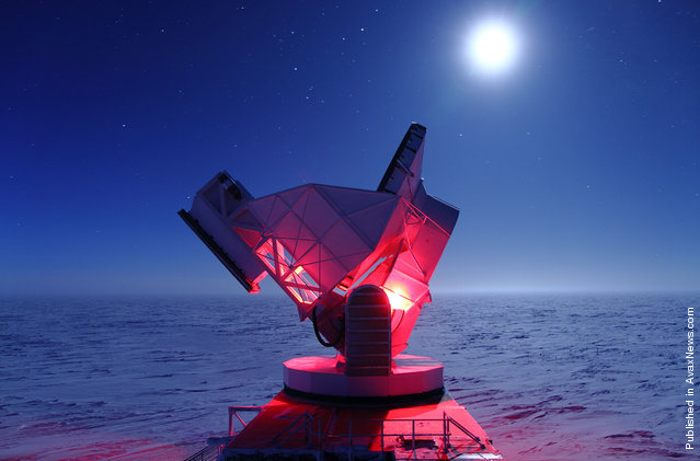 Red lights help maintenance workers doing routine repairs on the South Pole Telescope (SPT) on August 19, 2010