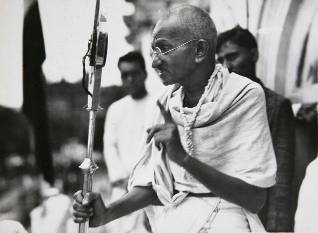 In this file photo dated 1931, Mahatma Gandhi talks to a crowd in India. (Photo by James A. Mills/AP Photo)
