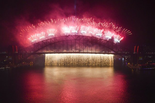 The midnight fireworks explode over the Sydney Harbour Bridge on Sydney Harbour during the Year's Eve celebrations in Sydney, Australia on January 1, 2020. (Photo by Lukas Coch/AAP Image for City of Sydney via Reuters)