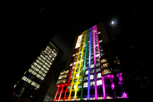 Mexico's Foreign Affairs building is illuminated in rainbow colours in tribute of the victims of the gay nightclub mass shooting in Orlando, in Mexico City, Mexico, June 13, 2016. (Photo by Edgard Garrido/Reuters)