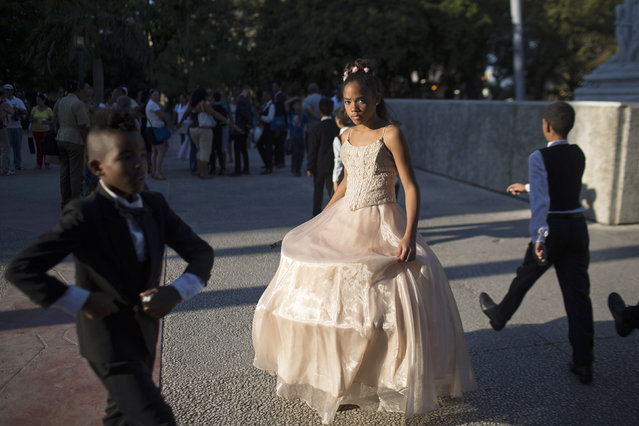 Cheila Martinez (C), 11, walks at the Marti park after performing with her dance school for the anniversary of the beginning of the last and decisive Cuban independence war, in downtown Havana, February 24, 2015. (Photo by Alexandre Meneghini/Reuters)