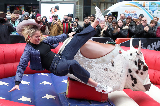 TV personalities Sara Haines, Keke Palmer and Michael Strahan are no match for a mechanical bull in Times Square in New York City; Pictured: Sara Haines. (Photo by Christopher Peterson/Splash News and Pictures)
