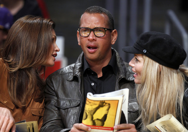 Alex Rodriguez reacts as he sits with Cindy Crawford and retired wrestler Torrie Wilson as the Lakers play the Rockets in Los Angeles, January 2012. (Photo by Lucy Nicholson/Reuters)