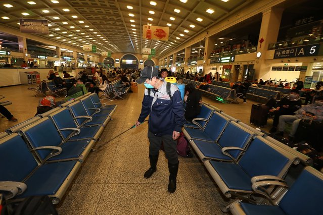 A staff member disinfects at the Hankou Railway Station in Wuhan, in China's central Hubei province early on January 22, 2020. The Chinese city at the centre of a SARS-like virus outbreak has urged people to stay away, cancelling a major Lunar New Year event, as it strives to contain a disease that has spread across the country. (Photo by AFP Photo/China Stringer Network)