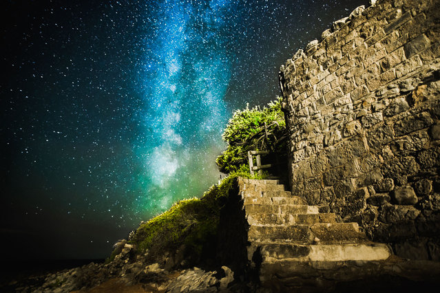 Milky Way behind the Orchard Bay steps on August 04, 2014, in Isle of Wight, UK. (Photo by Chad Powell/Barcroft Media)