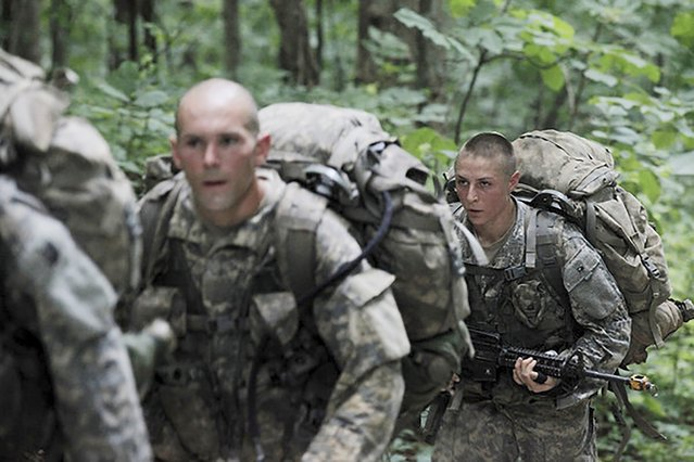 1st Lt. Shaye Haver (R) conducts Mountaineering training during the Ranger Course on Mount Yonah in Cleveland, Georgia July 14, 2015. (Photo by Pfc. Ebony Banks/Reuters/U.S. Army)