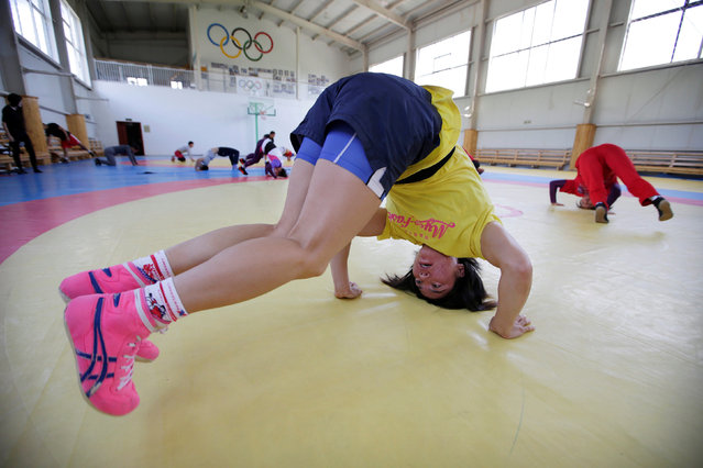 Mongolia's Olympic wrestler Battsetseg Soronzonbold stretches ahead of a daily training session at the Mongolia Women's National Wrestling Team training centre in Bayanzurkh district of Ulaanbaatar, Mongolia, July 1, 2016. (Photo by Jason Lee/Reuters)