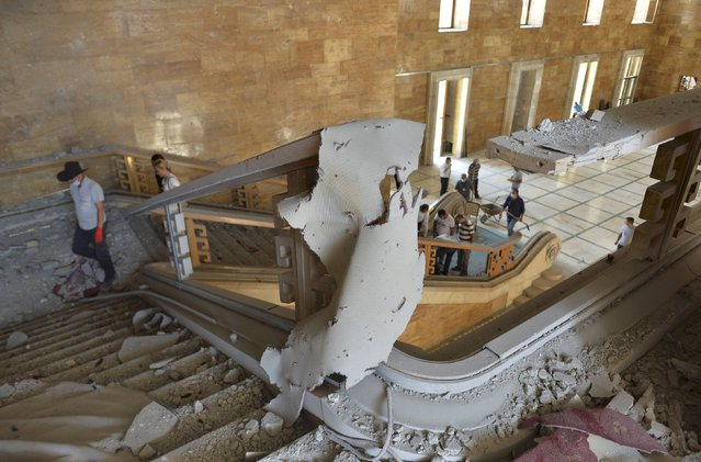 People walk inside the damaged parliament building in Ankara, Turkey, July 16, 2016. (Photo by Reuters/Stringer)