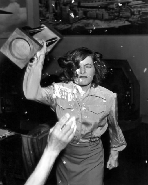"A no-holds-barred fight scene between actresses Jane Wyman (hand in foreground) and Margot Stevenson in the movie ""Flight Angels"", June 3, 1940. (Photo by AP Photo)"