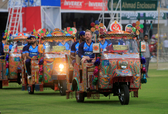 World XI players arrive on the pitch in rickshaws painted with truck art at Ghaddafi Cricket Stadium to play in the World XI cricket series in Lahore, Pakistan September 12, 2017. (Photo by Mohsin Raza/Reuters)