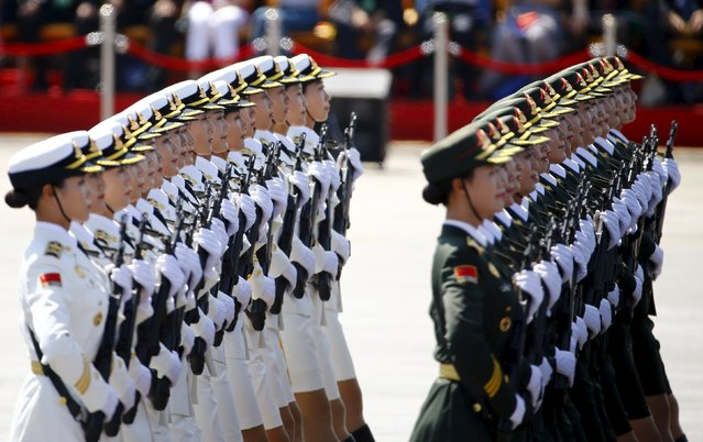 Female soldiers of China's People's Liberation Army (PLA) march during the military parade to mark the 70th anniversary of the end of World War Two, in Beijing, China, September 3, 2015. (Photo by Damir Sagolj/Reuters)