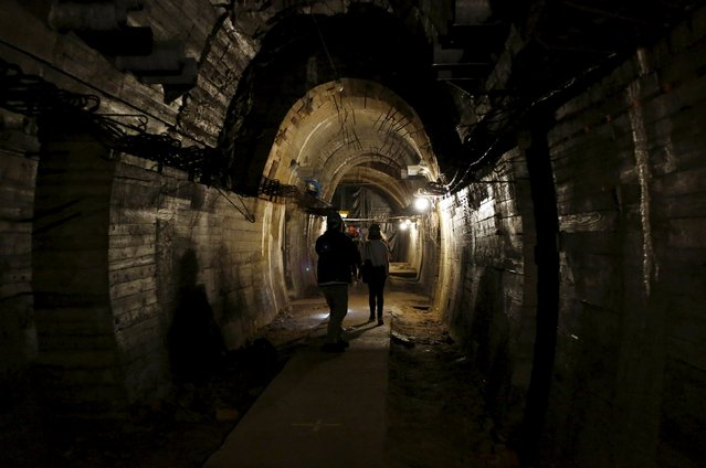 """People walk through a tunnel, which is part of the Nazi Germany """"Riese"""" construction project, under the Ksiaz castle in an area where a Nazi train is believed to be, in Walbrzych, southwestern Poland September 3, 2015. (Photo by Kacper Pempel/Reuters)"""