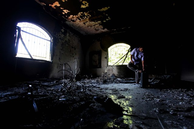 A man investigates the inside of the U.S. Consulate in Benghazi  on Thursday. (Photo by Mohammad Hannon/Associated Press)