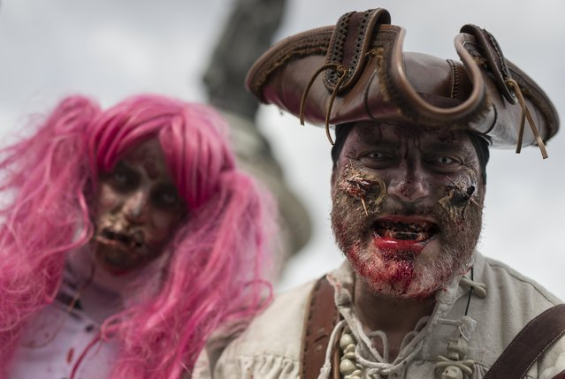A man dressed as a zombie participates in a walk for World Zombie Day 2017 on Place de la Republique in Paris, France, 07 October 2017. (Photo by Ian Langsdon/EPA/EFE)