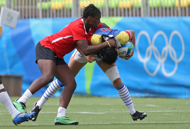 2016 Rio Olympics, Rugby, Women's Placing 11-12 Colombia vs Kenya, Deodoro Stadium, Rio de Janeiro, Brazil on August 8, 2016. Sharon Acevedo Tangarife (COL) of Colombia is tackled by Janet Musindalo Okelo (KEN) of Kenya. (Photo by Alessandro Bianchi/Reuters)