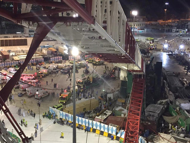 In this image released by the Saudi Interior Ministry's General Directorate of Civil Defense, a collapsed crane and emergency services vehicles are seen near the Grand Mosque in Mecca, Friday, September 11, 2015. (Photo by Saudi Interior Ministry General Directorate of Civil Defense via AP Photo)