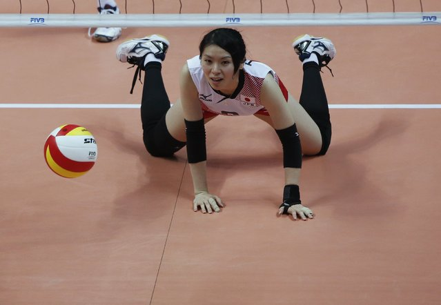 Japan's Miku Torigoe looks on after missing a shot during the women's Volleyball semi-final match against South Korea at the Ansan Sangroksu Gymnasium during the 17th Asian Games in Incheon September 30, 2014. (Photo by Kim Hong-Ji/Reuters)