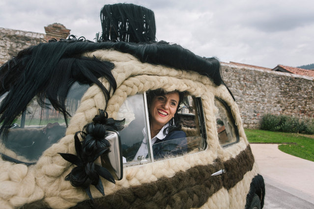 Hairstylist Maria Lucia Mugno (47), owner of the world's hairiest car, is seen here in her Fiat 500 in Padula, Italy, on October 22nd 2017. An Italian hairstylist has spent more than €80,000 covering her car in human hair. Paying tribute to her profession, Maria Lucia Mugno holds the official Guinness World Record for owning the world's hairiest car. Taking her more than 150 hours to complete, Maria's Fiat 500 is now concealed in 100kg of women's natural hair that she acquired from India. (Photo by Gianni Cipriano/Barcroft Media)