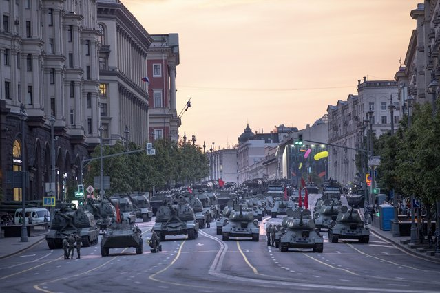 In this file photo taken on Thursday, June 18, 2020, Russian military vehicles prepare to roll along Tverskaya street toward Red Square during a rehearsal for the Victory Day military parade after sunset in Moscow, Russia. (Photo by Alexander Zemlianichenko/AP Photo/File)