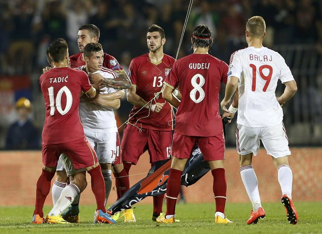 Players of Serbia (in red) and Albania scuffle during their Euro 2016 Group I qualifying soccer match at the FK Partizan stadium in Belgrade October 14, 2014. (Photo by Marko Djurica/Reuters)