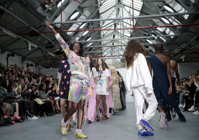 A model throws confetti during the presentation of the Ashish Spring/Summer 2016 collection during London Fashion Week in London, Britain September 22, 2015. (Photo by Suzanne Plunkett/Reuters)