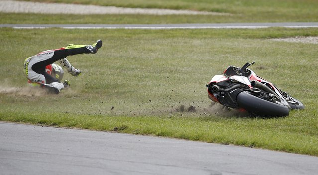 Pramac Racing MotoGP rider Andrea Iannone of Italy crashes out of the Australian Grand Prix on Phillip Island October 19, 2014. (Photo by Jason Reed/Reuters)