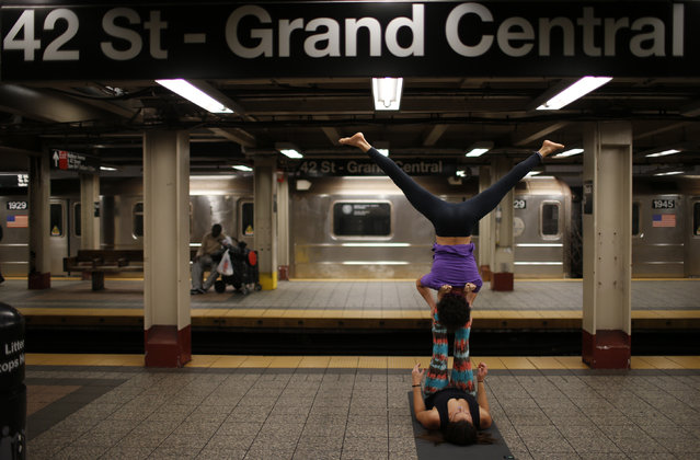 "Lauren Pallody and Bassam Kubba practice ""Acro-yoga"", a mixture of yoga and acrobatics on a subway platform at 42nd Street beneath Grand Central station in New York city, October 23, 2014. (Photo by Mike Segar/Reuters)"