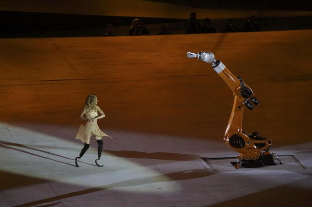 2016 Rio Paralympics, Opening ceremony, Maracana, Rio de Janeiro, Brazil on September 7, 2016. Amy Purdy interacts with a robotic arm during the opening ceremony. (Photo by Sergio Moraes/Reuters)