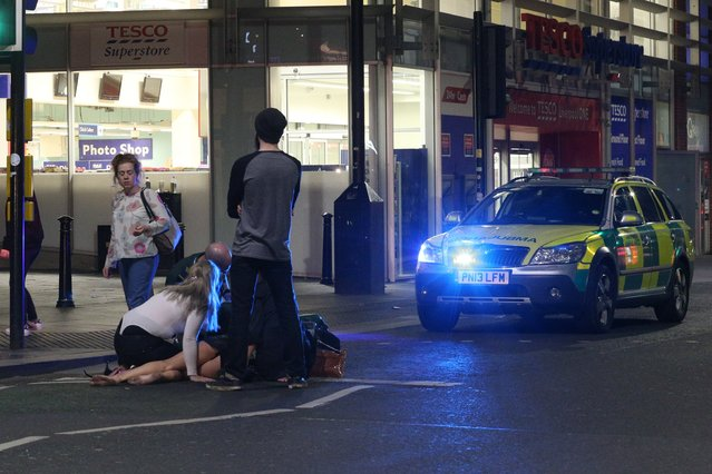 An ambulance is called to tend to someone who may have had too much to drink on a night out from Liverpool University in Liverpool, United Kingdom on September 21, 2016. (Photo by Paul Jacobs/FameFlynet UK)