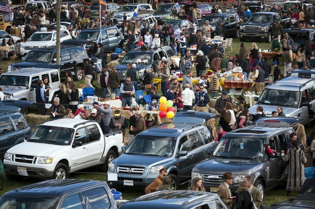 Revellers park their cars in a field for a tailgate party at the Far Hills Race Day at Moorland Farms in Far Hills, New Jersey, October 17, 2015. Young locals in New Jersey catch up with friends from school and college days at the Far Hills Race Day, which started as a fox-hunting event in the early 1900s. (Photo by Stephanie Keith/Reuters)