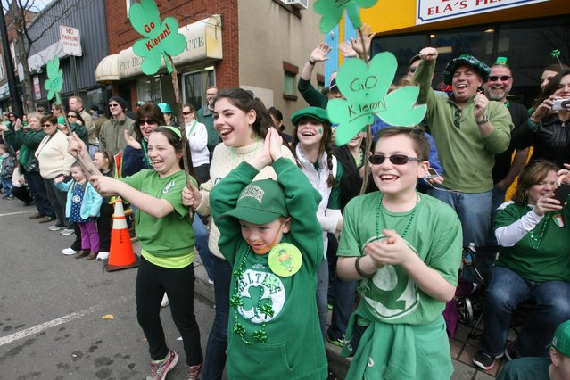 The crowd cheering for the Ridgewood School of Irish Dancing during the 32nd Bergen County St. Patrick's Day Parade, Sunday, March 10, 2013 in Bergenfield, N.J. (Photo by Chris Pedota/AP Photo/The Record)