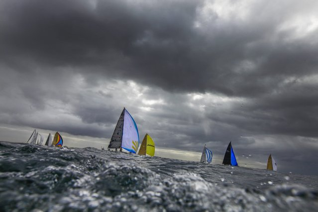 Yachts sail at the start of South Africa's oldest ocean race the Mossel Bay race in Cape Town, South Africa, 29 September 2016. The 200 nautical mile race between Simonstown and Mossel Bay sees South Africa's premier racing yachts competing to see who is the fastest to get around the southern most tip of the African continent the notorious Cape Agulhas. (Photo by Nic Bothma/EPA)