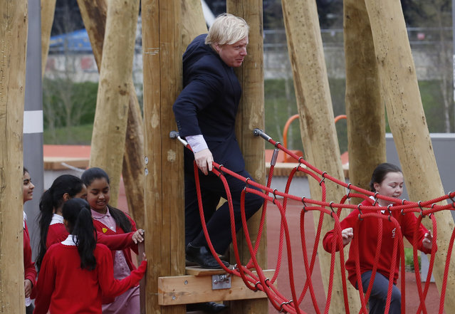 Mayor of London Boris Johnson squeezes onto a children's play rope bridge when he and Prince Harry (not pictured) viewed the Queen Elizabeth Olympic Park ahead of its opening at Stratford in east London April 4, 2014. (Photo by Luke MacGregor/Reuters)