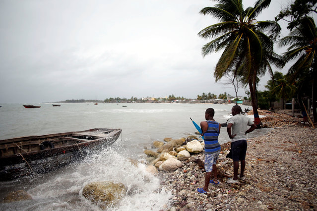 Two men look at anchored boats as Hurricane Matthew approaches in Les Cayes, Haiti, October 3, 2016. (Photo by Andres Martinez Casares/Reuters)