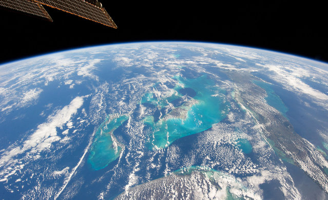 A photograph taken by a member of Expedition 34, aboard the International Space Station, looking down on the Bahamas from orbit, on January 13, 2013. (Photo by NASA/The Atlantic)