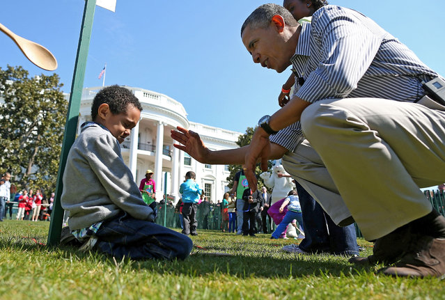 U.S. President Barack Obama comforts crying 5-year-old Donaivan Frazier during the annual Easter Egg Roll on the White House tennis court April 1, 2013 in Washington, D.C. Thousands of people are expected to attend the 134-year-old tradition of rolling colored eggs down the White House lawn that was started by President Rutherford B. Hayes in 1878.  (Photo by Mark Wilson/Abaca Press/MCT)