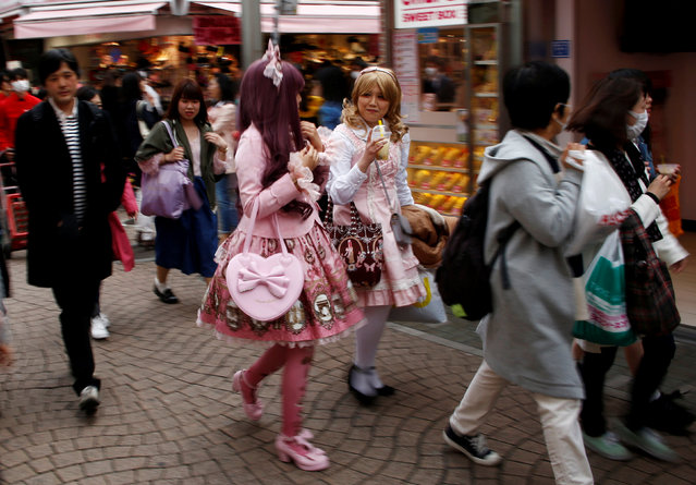 "Sera (R) and Riri dressed in ""Lolita fashion"" which influenced by Victorian style, make their way at  Harajuku shopping district in Tokyo, Japan March 15, 2018. (Photo by Kim Kyung-Hoon/Reuters)"
