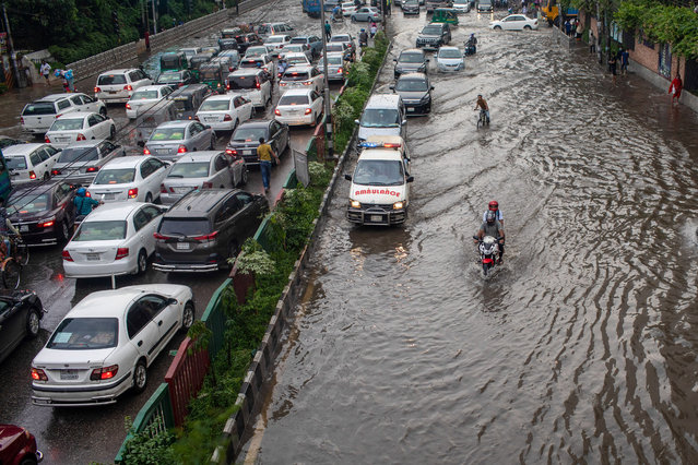 Traffic on Mirpur road which is waterlogged following heavy rains causing much suffering for pedestrians and commuters on October 14, 2020. (Photo by Sazzad Hossain/SOPA Images/Rex Features/Shutterstock)