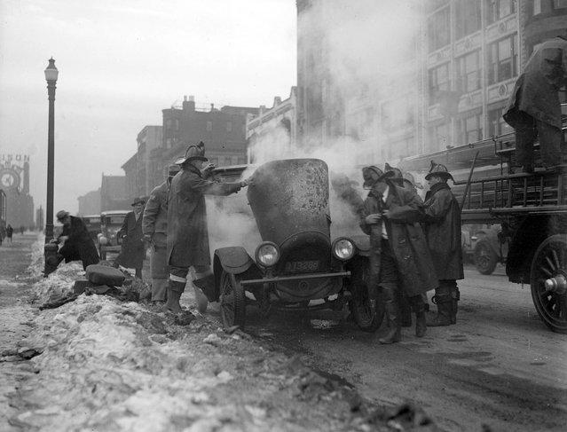 Auto catches fire on Boylston St. Boston, 1929. (Photo by Leslie Jones)
