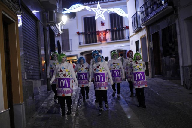 Revellers dressed up as a McFlurry ice cream take part in New Year's celebrations in Coin, near Malaga, southern Spain, early January 1, 2015. (Photo by Jon Nazca/Reuters)