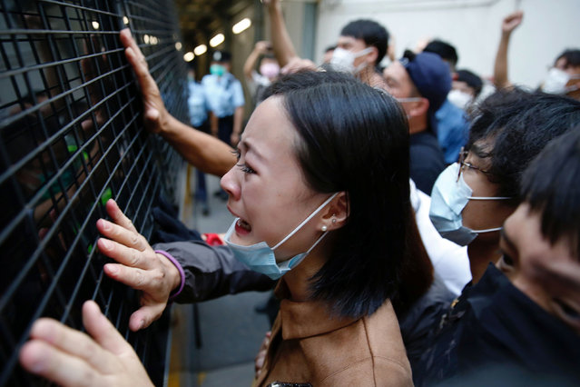 A family member cries and bid farewell to a prison van after an anti-government protester Sin Ka-ho has been sentenced four years for rioting, in Hong Kong, China on May 15, 2020. (Photo by Tyrone Siu/Reuters)