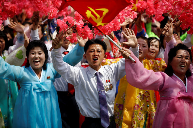 People react as they see North Korean leader Kim Jong Un during a military parade marking the 105th anniversary of the country's founding father Kim Il Sung's birth, in Pyongyang, North Korea, April 15, 2017. (Photo by Damir Sagolj/Reuters)