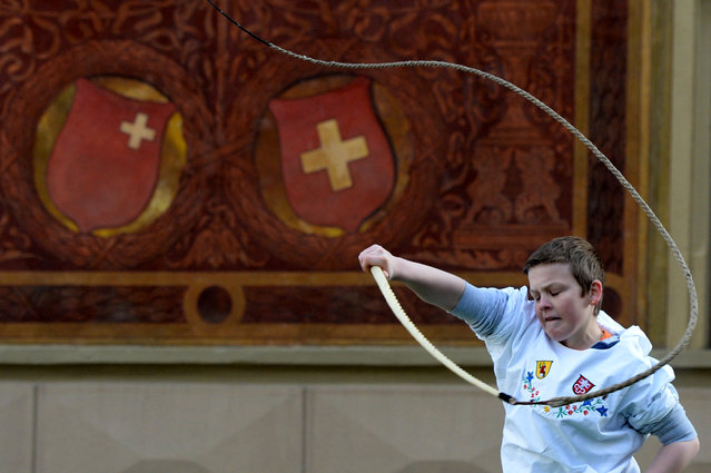 A whipcracker performs during the 48th edition of the Swiss whipcracking championships on the main square in Schwyz, central Switzerland, January 6, 2015. (Photo by Urs Flueeler/EPA)
